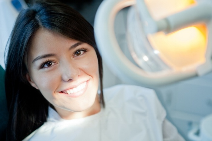 Young woman portrait visiting the dentist and smiling-573233-edited.jpeg