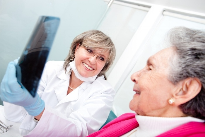 Dentist with an elder female patient looking at an x-ray-406776-edited.jpeg