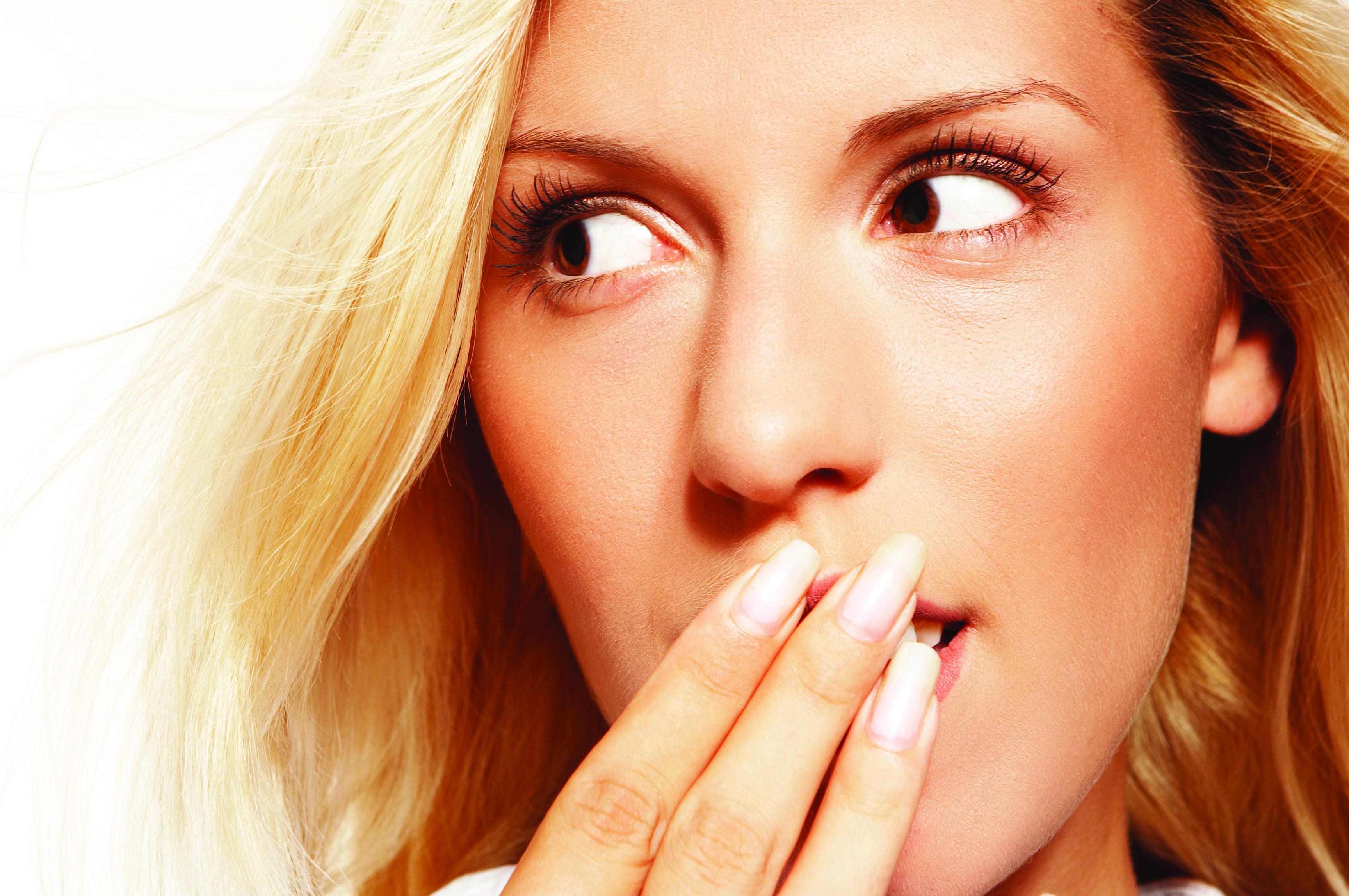 Woman hiding teeth.jpg